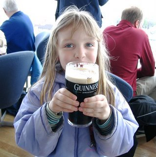 Little girl drinking Guinness