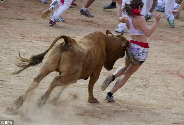 Girl in running with the bulls